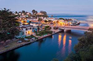 Bridges over Soquel Creek and village at dusk. Capitola, California, USA